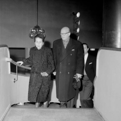"Prime Minister Urho Kekkonen and Mrs Sylvi Kekkonen arriving at a special screening of the film Tuntematon Sotilas (""The Unknown Soldier"") at the Bio Rex cinema in December 1955. <em>Unknown photographer, Helsinki 22 December 1955. Finnish Museum of Photography/Alma Media/Uusi Suomi Collection</em>"